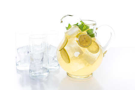 Green tea with citrus on a white backgound. Stock Photo