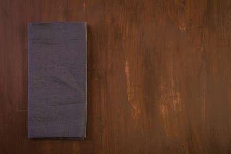 Linen dinner napkins on a wood background.