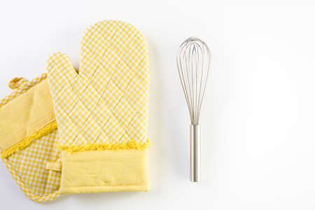 Yellow oven mitt on a white background. Reklamní fotografie