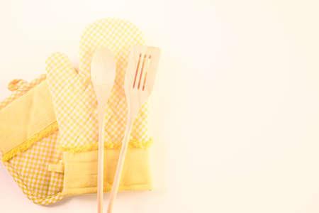 mitt: Yellow oven mitt on a white background. Stock Photo