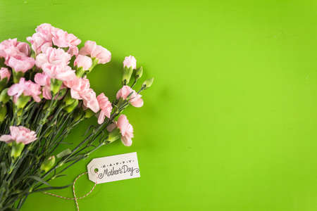 Decorations for Mothers Day on a  wood board. Stock Photo