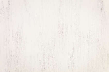 Painted white textured wood background.