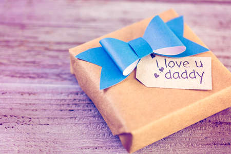 Wrapped in drown paper gift for Father's Day. Фото со стока - 73257554