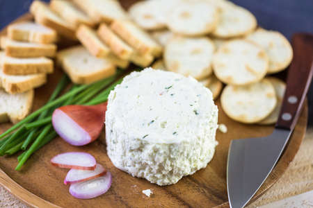 Soft flavored creamy cheese with shallot and chive. Stock Photo