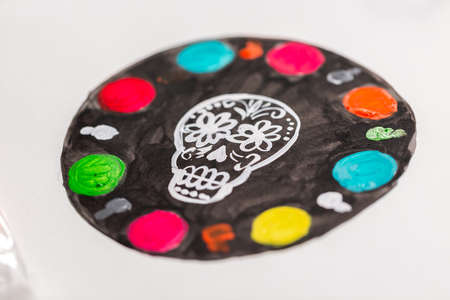 Designing six layer chocolate cake for Dia de los Muertos holiday.