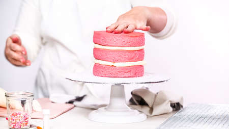 Step by step. Stacking layers together of pink birthday cake. Stok Fotoğraf
