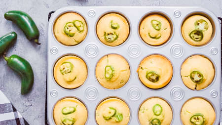 Step by step. Flat lay. Fresh out of the oven spicy jalapeno cornbread muffins.