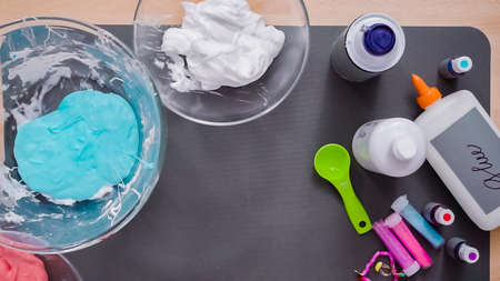 Step by step. Flat lay. Kids project with colorful fluffy slime. Stock Photo