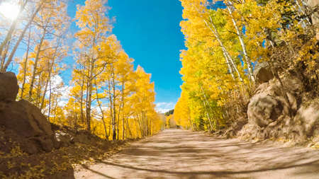 Driving on small mountain dirt roads from Colorado Springs to Cripple Creek in Autumn. Stock Photo - 111198084