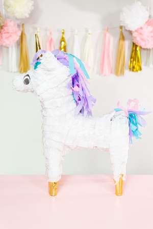 Large unicorn pinata at little girl's birthday party. Stock Photo