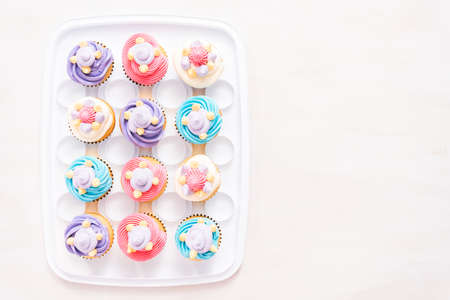 Unicorn theme vanilla cupcakes for kids birthday party. Stock Photo