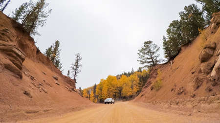 Driving on small mountain dirt roads from Colorado Springs to Cripple Creek in Autumn. Stock Photo - 111198492