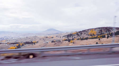 Driving on mountain highway 67 to Colorado Springs in Autumn.