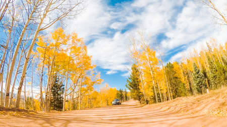 Driving on small mountain dirt roads from Colorado Springs to Cripple Creek in Autumn. Stock Photo - 111199169