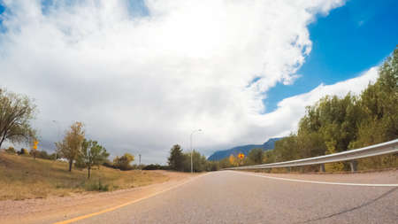 Driving on mountain highway 24 to Colorado Springs in Autumn.