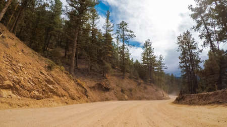 Driving on small mountain dirt roads from Colorado Springs to Cripple Creek in Autumn.
