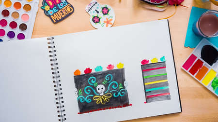 Step by step. Flat lay. Baker sketching a design of a cake with watercolors for  holiday.