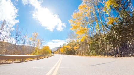 Driving on mountain highway 67 to Victor in Autumn.