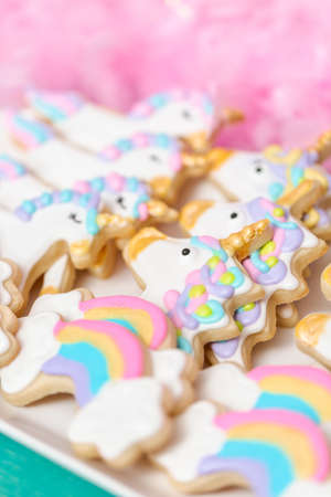 Unicorn sugar cookies decorated with royal icing at the kids birthday party. Stock fotó