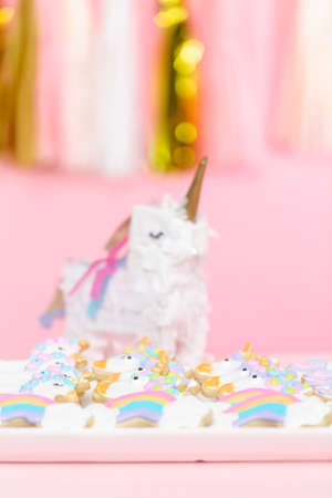 Unicorn sugar cookies decorated with royal icing at the kids birthday party. Stock Photo