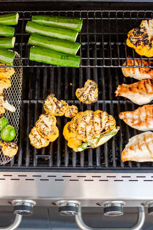 Cooking healthy dinner on outdoor gas grill. Stock Photo