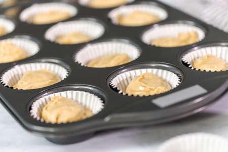 Vanilla cupcake batter in cupcake pan.