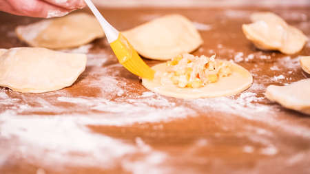 Step by step. Making home made empanadas with different fillings. Stock Photo