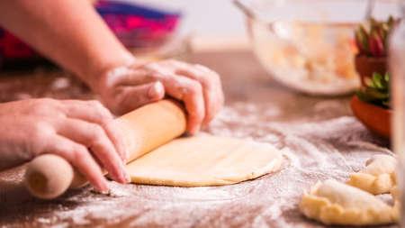 Step by step. Rolling dough for home made empanadas. Reklamní fotografie