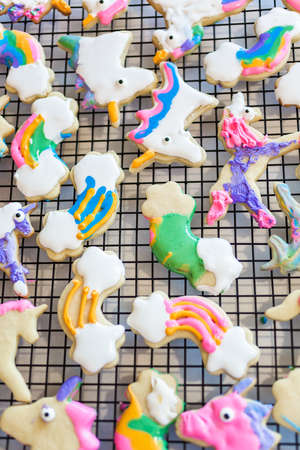 Kids craft. Decorated with royal icing unicorn cookies on drying rack.