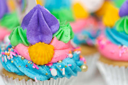 Close up of unicorn cupcakes with multicolor buttercream icing.