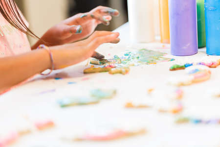 Little girls making unicorn cookies at the play date. Banco de Imagens
