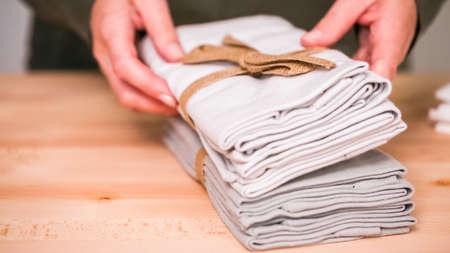 New linen dinner napkin on wood table.
