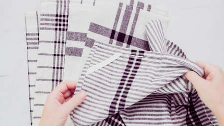 Folding Blck and white patterned paper towels on marble surface. Reklamní fotografie - 112035854