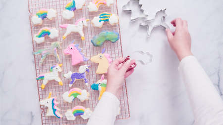 Unicorn cookies decorated with royal icing drying on drying rack. Stock fotó
