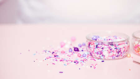 Colorful sprinkle blend on a pink background. 写真素材
