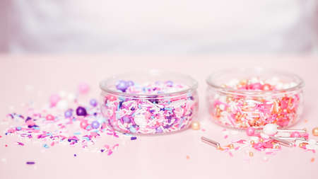 Colorful sprinkle blend on a pink background. Stockfoto
