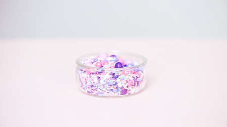 Colorful purple sprinkle blend on a pink background. Stockfoto