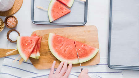 Step by step. Slicing watermelon into wadges to make watermelon ice pops.
