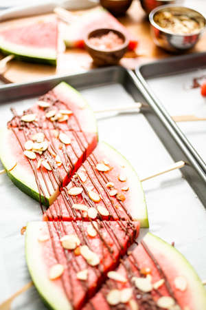 Watermelon drizzled with chocolate and topped with flaked sea salt and almonds.