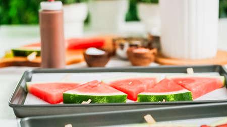 Step by step. Drizzling chocolate on watermelon ice pops. Stok Fotoğraf