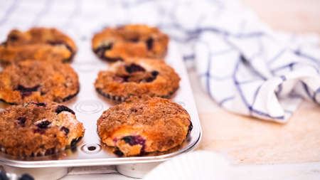 Out of the oven blueberry muffins with cinnamon and sugar topping. Stock fotó