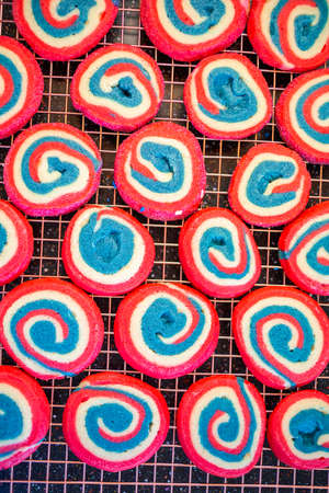 Red white and blue pinwheel sugar cookies for July 4th celebration.