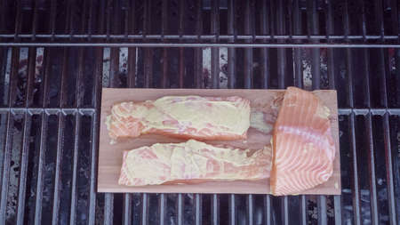 Step by step. Grilled salmon on plank in dijon mustard.