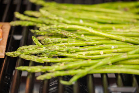 Grilling fresh asparagus on outdoor gas grill. 写真素材