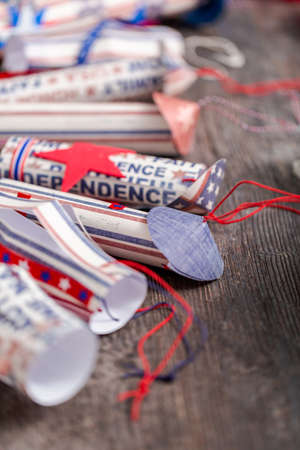 Paper firecrackers made from red, white and blue paper for July 4th celebration. Stock Photo