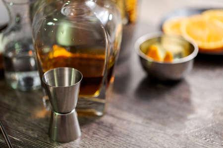Bourbon old fashioned cocktail garnished with orange peel.