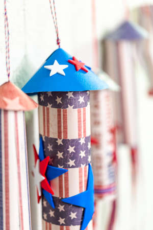 Paper firecrackers made from red, white and blue paper for July 4th celebration. Reklamní fotografie