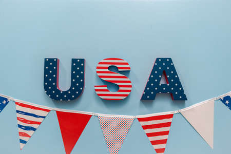 Painted USA sign with white, red and blue on blue background.