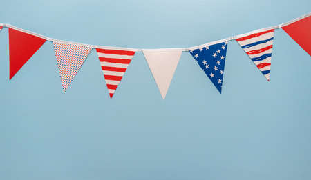July 4th theme paper garland on blue background.