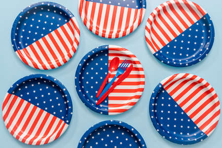 July 4th theme paper plate on blue background.